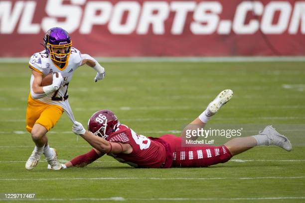 Tyler Snead of the East Carolina Pirates runs with the ball against Aaron Jarman of the Temple Owls in the first half at Lincoln Financial Field on...