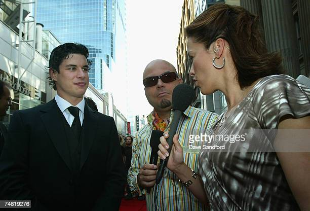 Tyler Stewart of the Barenaked Ladies and Cassie Campbell of Team Canada interview Sidney Crosby of the Pittsburgh Penguins during arrivals to the...