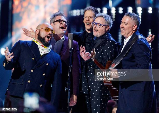 Tyler Stewart Steven Page Jim Creeggan Kevin Hearn and Ed Robertson of Barenaked Ladies perform on stage during the 2018 JUNO Awards at Rogers Arena...