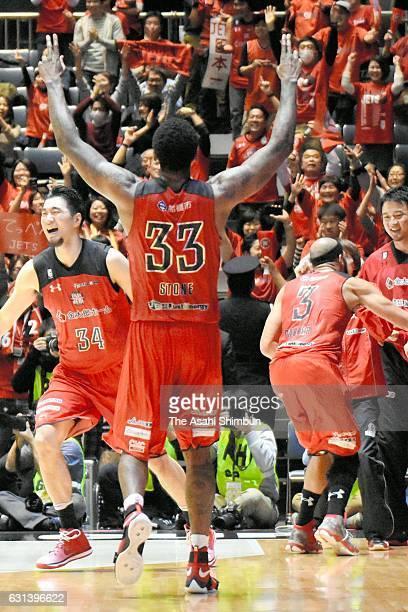 Tyler Stone and Chiba Jets players celebrate winning the 92nd Emperor's Cup All Japan Men's Basketball Championship final at Yoyogi National...