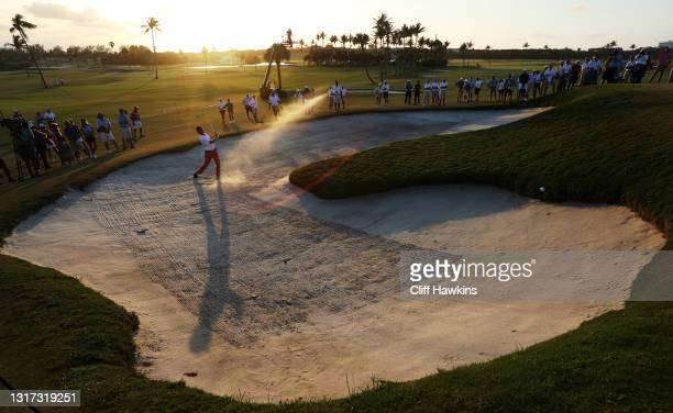 Tyler Strafaci of Team USA plays his shot from the bunker on the 18th hole during Sunday singles matches on Day Two of The Walker Cup at Seminole...