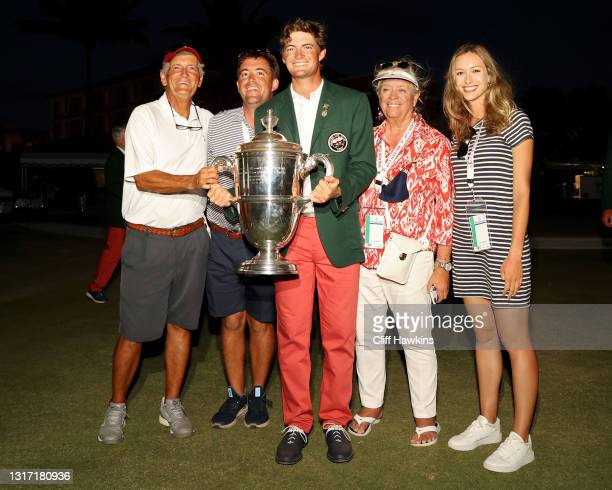 Tyler Strafaci of Team USA poses for photos with his family after Team USA defeated Team Great Britain and Ireland 14-12 during Sunday singles...