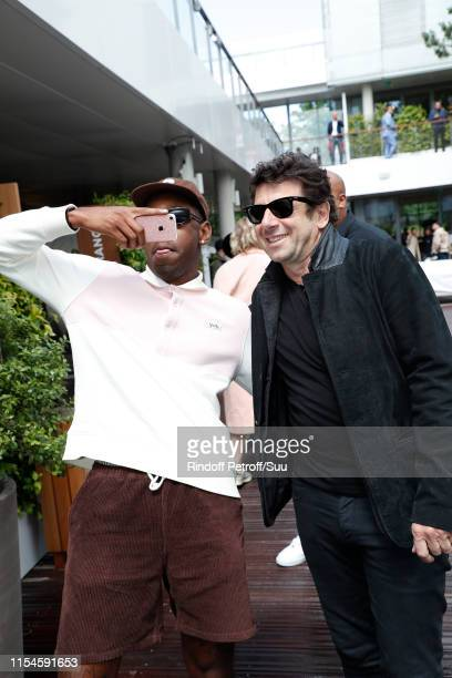 Tyler The Creator aka Tyler Okonma and Patrick Bruel attend the 2019 French Tennis Open Day Fourteen at Roland Garros on June 08 2019 in Paris France