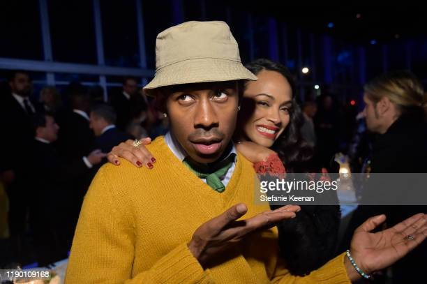 Tyler the Creator and Zoe Saldana both wearing Gucci attend the 2019 LACMA Art Film Gala Presented By Gucci at LACMA on November 02 2019 in Los...