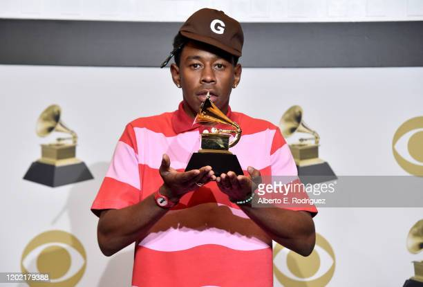 """Tyler, the Creator, winner for the Best Rap Album for """"Igor"""", poses in the press room during the 62nd Annual GRAMMY Awards at STAPLES Center on..."""