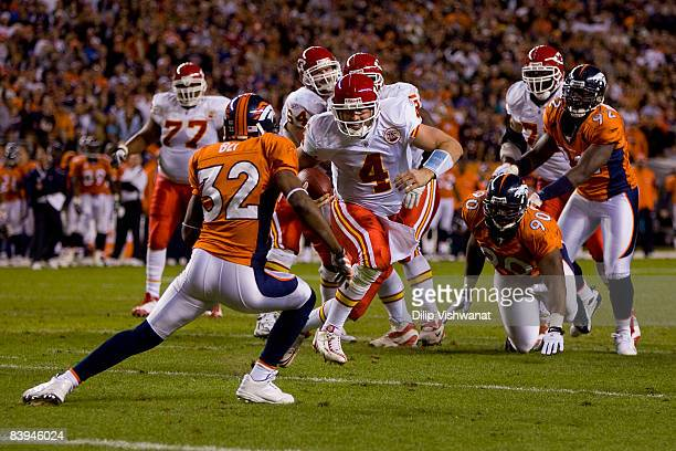 Tyler Thigpen of the Kansas City Chiefs attempts to scramble for a game-tying touchdown against Dre Bly of the Denver Broncos at Invesco Field at...
