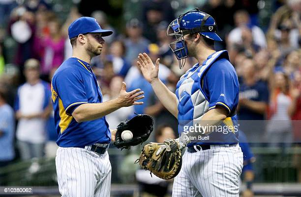 Tyler Thornburg and Andrew Susac of the Milwaukee Brewers celebrate after beating the Cincinnati Reds 54 at Miller Park on September 23 2016 in...
