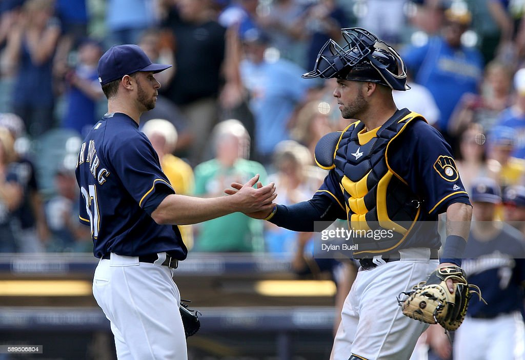 Tyler Thornburg #37 and Manny Pina #9 of the Milwaukee Brewers celebrate after beating the Cincinnati Reds 7-3 at Miller Park on August 14, 2016 in Milwaukee, Wisconsin.