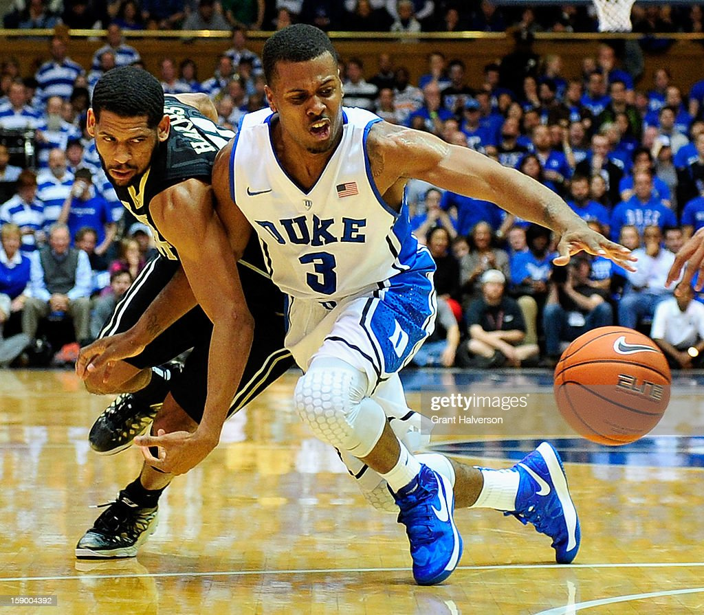 Tyler Thornton #3 of the Duke Blue Devils battles for a loose ball with C.J. Harris #11 of the Wake Forest Demon Deacons during play at Cameron Indoor Stadium on January 5, 2013 in Durham, North Carolina.