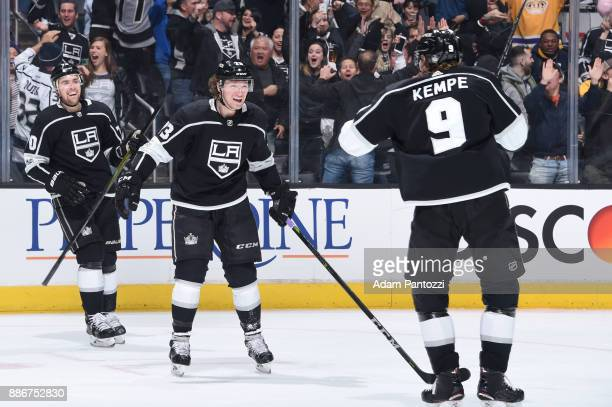 Tyler Toffoli and Adrian Kempe of the Los Angeles Kings celebrate after scoring a goal during a game against the Minnesota Wild at STAPLES Center on...