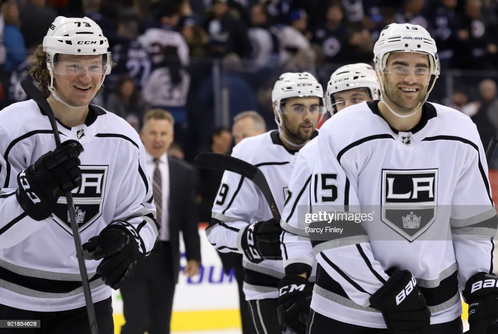 Tyler Toffoli #73 and Andy Andreoff #15 of the Los Angeles Kings are all smiles as they leave the ice following a 4-3 victory over the Winnipeg Jets at the Bell MTS Place on February 20, 2018 in Winnipeg, Manitoba, Canada.