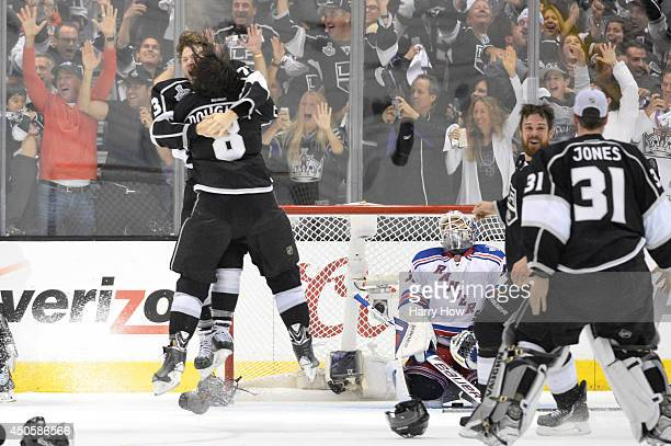 Tyler Toffoli and Drew Doughty of the Los Angeles Kings celebrate after teammate Alec Martinez scores the gamewinning goal in double overtime against...