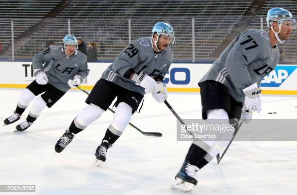 Tyler Toffoli Martin Frk and Jeff Carter of the Los Angeles Kings skate during practice prior to the 2020 NHL Stadium Series game against the...