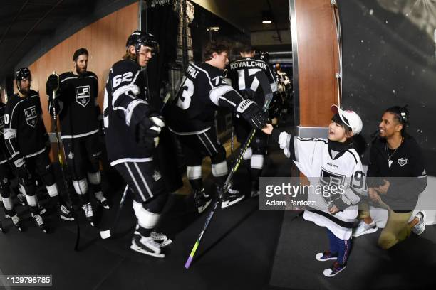Tyler Toffoli of the Los Angeles Kings and a young Kings fan highfive as he and his teammates take the ice for warmup before the game against the...