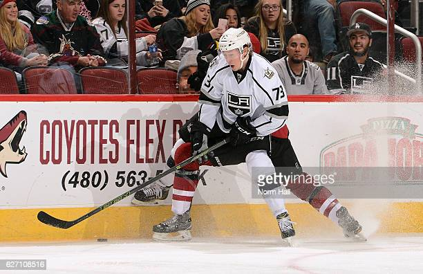 Tyler Toffoli of the Los Angeles Kings and Connor Murphy of the Arizona Coyotes battle for the puck along the boards during the third period at Gila...