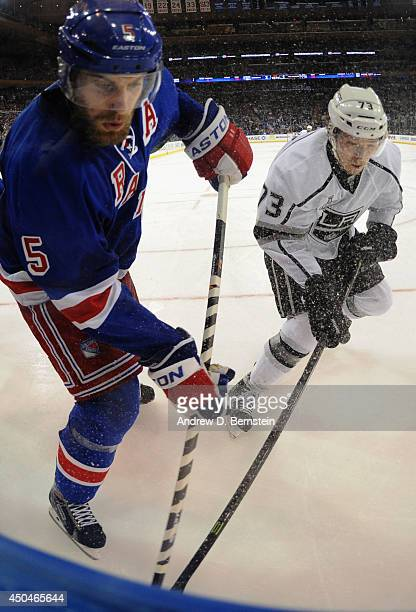 Tyler Toffoli of the Los Angeles Kings and Dan Girardi of the New York Rangers battle for the puck in the third period of Game Four of the 2014...