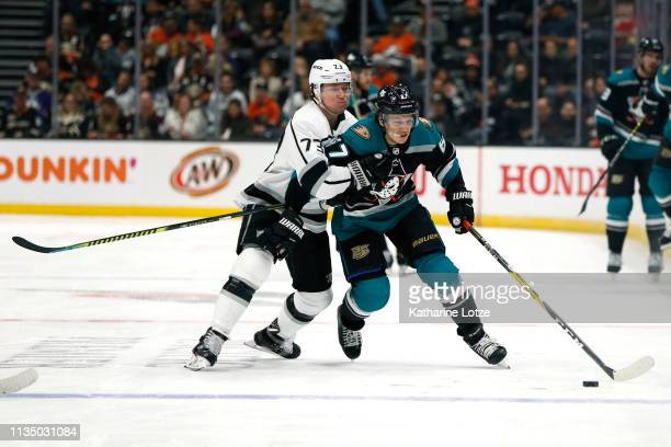 Tyler Toffoli of the Los Angeles Kings and Rickard Rakell of the Anaheim Ducks fight for control of the puck during the third period at Honda Center...