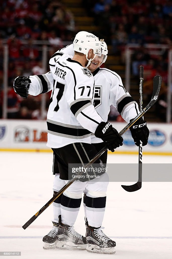 Tyler Toffoli #73 of the Los Angeles Kings celebrates a third period goal with Jeff Carter #77 while playing the Detroit Red Wings at Joe Louis Arena on December 15, 2016 in Detroit, Michigan. Los Angeles won the game 4-1.