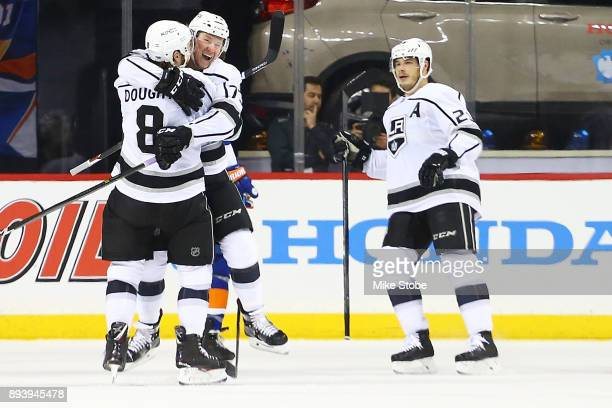 Tyler Toffoli of the Los Angeles Kings celebrates his first period goal against the New York Islanders with teammates Drew Doughty and Dustin Brown...