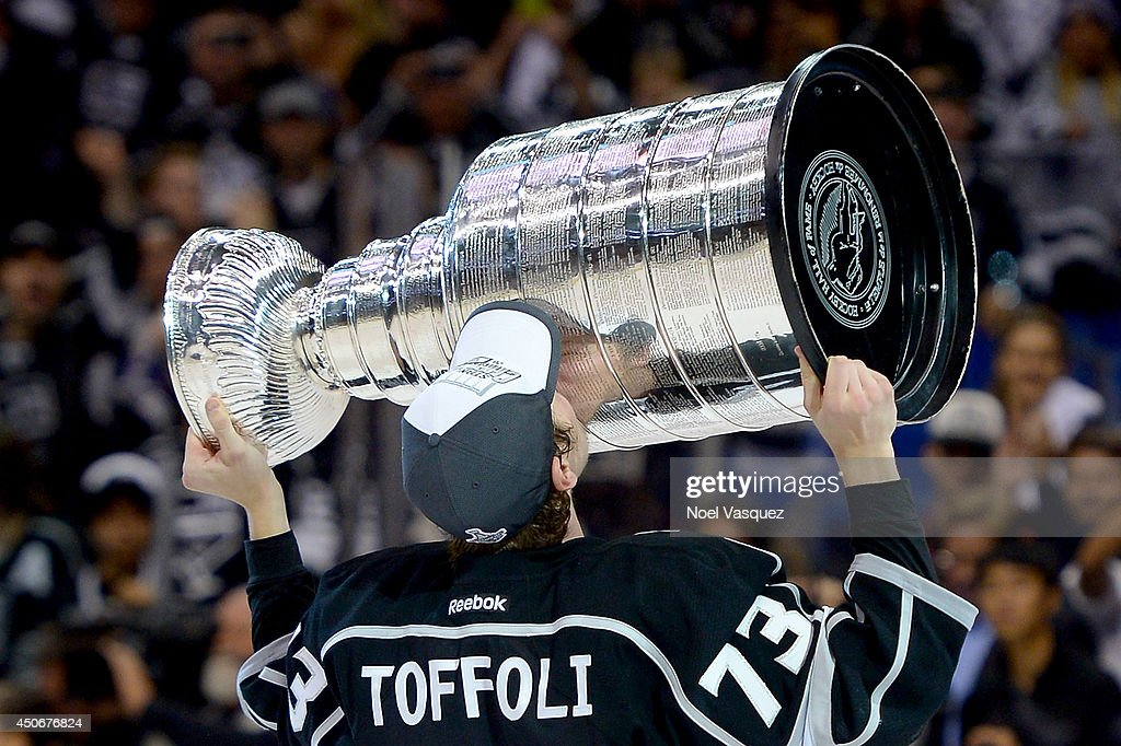 Tyler Toffoli #73 of the Los Angeles Kings celebrates with the Stanley Cup after the Kings 3-2 double overtime victory against the New York Rangers in Game Five of the 2014 Stanley Cup Final at Staples Center on June 13, 2014 in Los Angeles, California.
