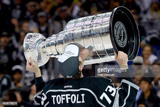 Tyler Toffoli of the Los Angeles Kings celebrates with the Stanley Cup after the Kings 3-2 double overtime victory against the New York Rangers in...