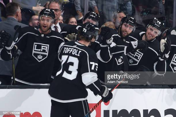 Tyler Toffoli of the Los Angeles Kings celebrates with Trevor Lewis Michael Amadio and Tanner Pearson on the beach after scoring a firstperiod goal...