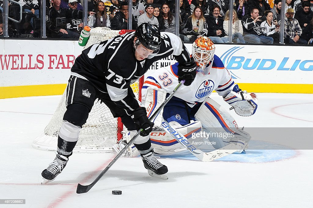 Tyler Toffoli #73 of the Los Angeles Kings handles the puck against Cam Talbot #33 of the Edmonton Oilers at STAPLES Center on November 14, 2015 in Los Angeles, California.
