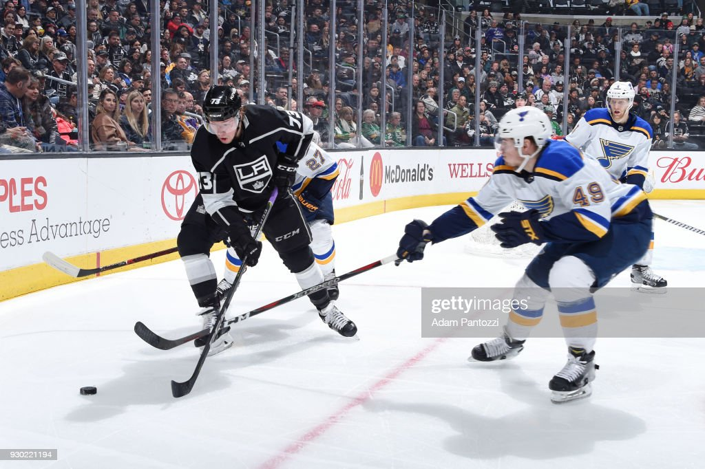 Tyler Toffoli #73 of the Los Angeles Kings handles the puck against Ivan Barbashev #49 of the St. Louis Blues at STAPLES Center on March 10, 2018 in Los Angeles, California.