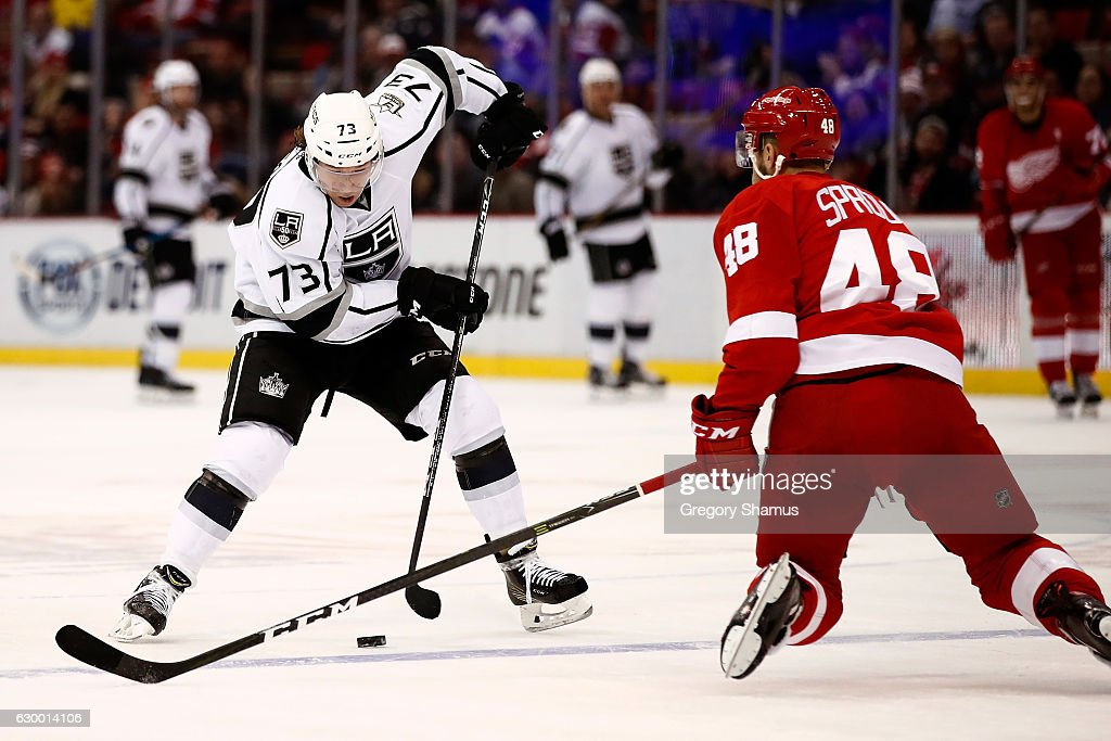 Tyler Toffoli #73 of the Los Angeles Kings makes a move around Ryan Sproul #48 of the Detroit Red Wings and goes on to score a open net third period goal at Joe Louis Arena on December 15, 2016 in Detroit, Michigan. Los Angeles won the game 4-1.