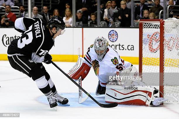 Tyler Toffoli of the Los Angeles Kings scores a second period goal past goaltender Corey Crawford of the Chicago Blackhawks in Game Three of the...