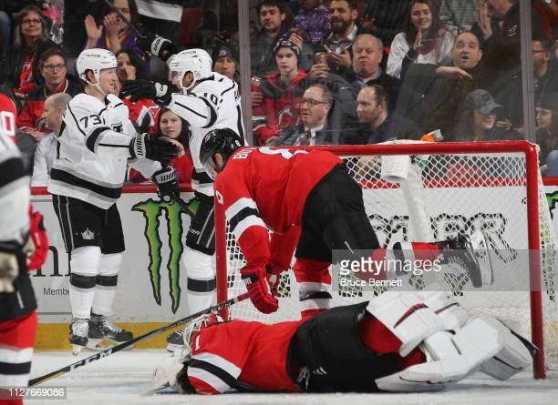 Tyler Toffoli of the Los Angeles Kings scores at 32 seconds of the third period on the powerplay against Keith Kinkaid of the New Jersey Devils and...