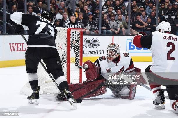 Tyler Toffoli of the Los Angeles Kings shoots the puck against Louis Domingue of the Arizona Coyotes at STAPLES Center on March 14 2017 in Los...