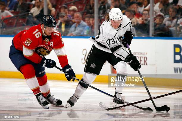 Tyler Toffoli of the Los Angeles Kings skates with the puck against Aleksander Barkov of the Florida Panthers at the BBT Center on February 9 2018 in...