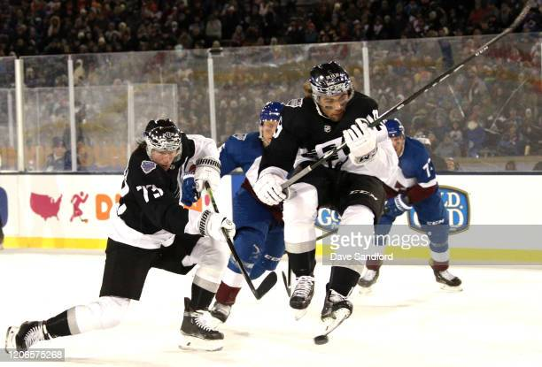 Tyler Toffoli of the Los Angeles Kings tries for a shot on goal as teammate Alex Iafallo jumps during the third period of the 2020 NHL Stadium Series...