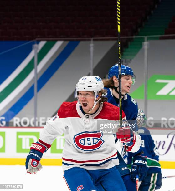 Tyler Toffoli of the Montreal Canadiens celebrate after scoring a goal while Adam Gaudette of the Vancouver Canucks reacts during NHL hockey action...