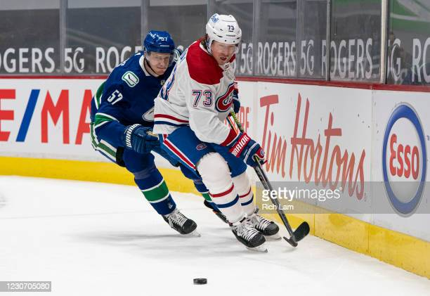 Tyler Toffoli of the Montreal Canadiens picks up the loose puck while chased by Tyler Myers during NHL hockey action at Rogers Arena on January 20,...
