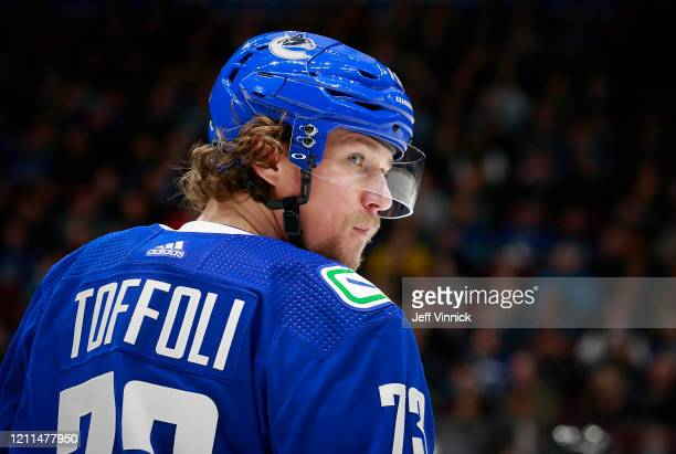 Tyler Toffoli of the Vancouver Canucks looks on from the bench during their NHL game against the Arizona Coyotes at Rogers Arena March 4, 2020 in...