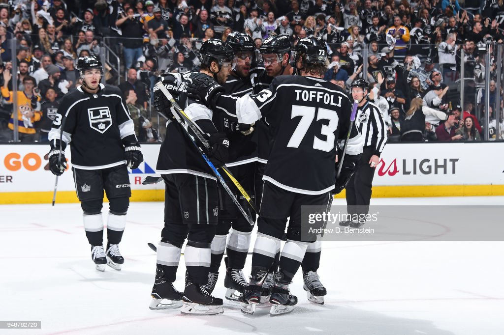 Tyler Toffoli #73, Oscar Fantenberg #7, Anze Kopitar #11, and Jeff Carter #77 of the Los Angeles Kings celebrate after scoring a goal against the Vegas Golden Knights in Game Three of the Western Conference First Round during the 2018 NHL Stanley Cup Playoffs at STAPLES Center on April 15, 2018 in Los Angeles, California.