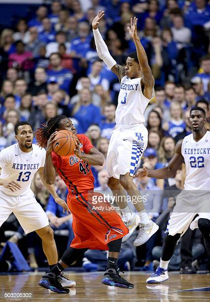 Tyler Ulis of the Kentucky Wildcats defends Stefan Moody of the Mississippi Rebels at Rupp Arena on January 2 2016 in Lexington Kentucky