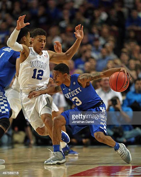 Tyler Ulis of the Kentucky Wildcats moves against Derryck Thornton of the Duke Blue Devils during the Champions Classic at the United Center on...