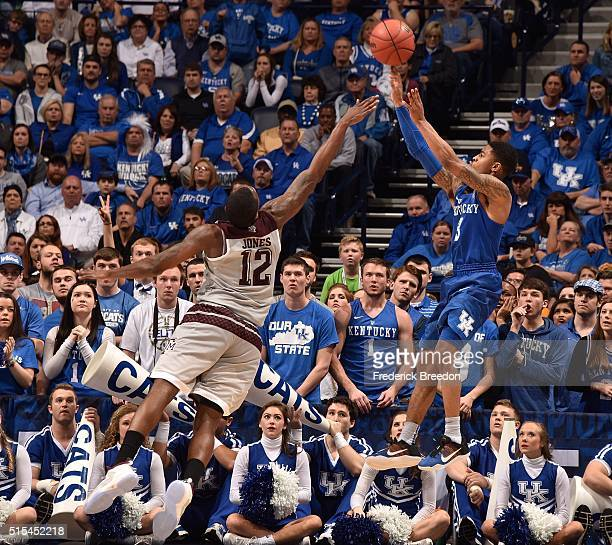 Tyler Ulis of the Kentucky Wildcats takes a shot over the outstretched arm of Jalen Jones of the Texas AM Aggies during the second half of the SEC...
