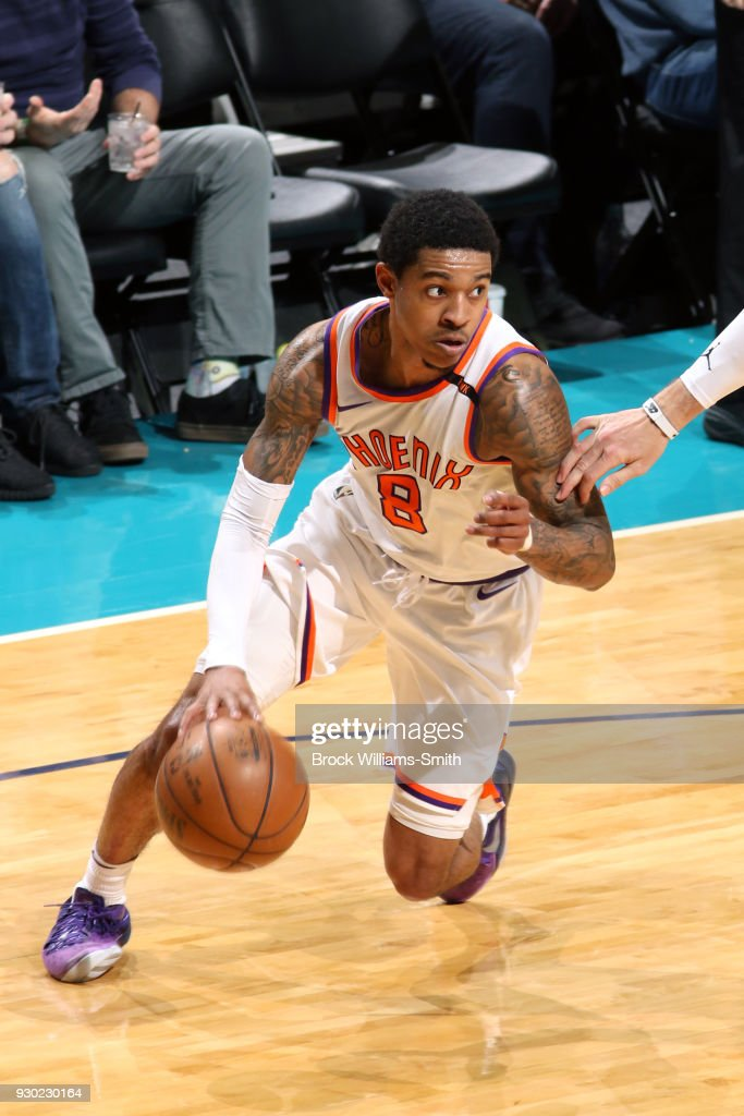 Tyler Ulis #8 of the Phoenix Suns handles the ball against the Charlotte Hornets on March 10, 2018 at Spectrum Center in Charlotte, North Carolina.
