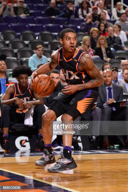 Tyler Ulis of the Phoenix Suns handles the ball against the Washington Wizards on December 7 2017 at Talking Stick Resort Arena in Phoenix Arizona...
