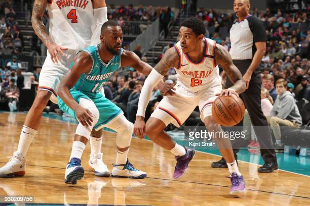 Tyler Ulis of the Phoenix Suns handles the ball during the game against the Charlotte Hornets on March 10 2018 at Spectrum Center in Charlotte North...