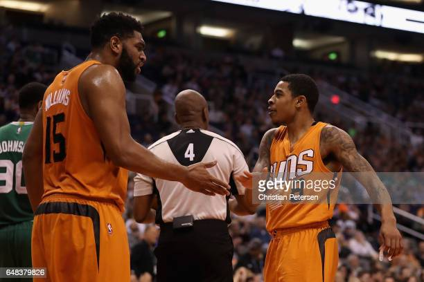 Tyler Ulis of the Phoenix Suns high fives Alan Williams after scoring against the Boston Celtics during the first half of the NBA game at Talking...