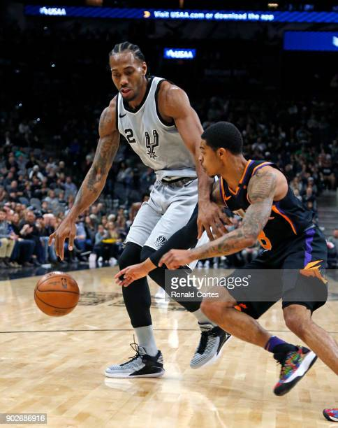 Tyler Ulis of the Phoenix Suns tries to steal the ball from Kawhi Leonard of the San Antonio Spurs at ATT Center on January 05 2018 in San Antonio...