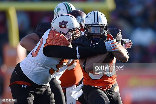 Tyler Varga of the North team is brought down by Gabe Wright of the South team during the first quarter of the Reese's Senior Bowl at Ladd Peebles...