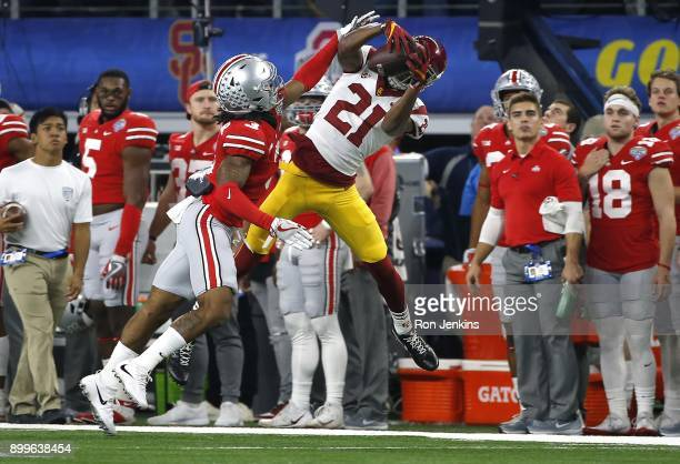 Tyler Vaughns of the USC Trojans catches a pass for a first down against Damon Arnette of the Ohio State Buckeyes in the first half of the 82nd...