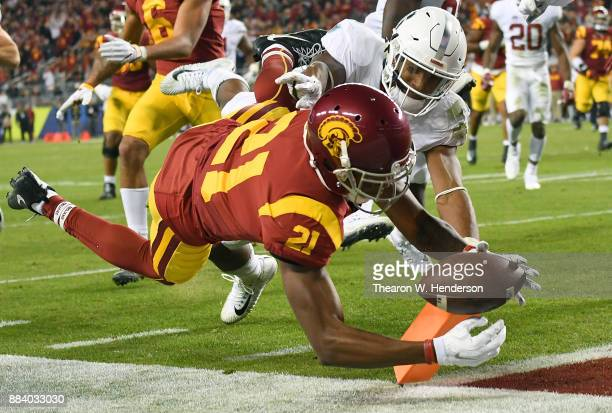 Tyler Vaughns of the USC Trojans dives into the endzone for a touchdown against the Stanford Cardinal during the Pac12 Football Championship Game at...