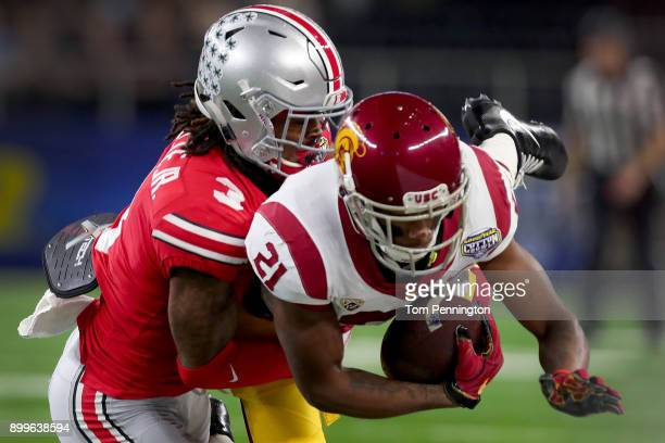 Tyler Vaughns of the USC Trojans pulls in a pass against Damon Arnette of the Ohio State Buckeyes in the first quarter during the Goodyear Cotton...